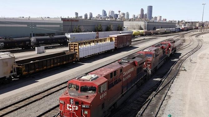 A Canadian Pacific Railway crew works on their train at the CP Rail yards in Calgary