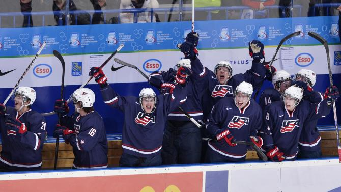 Team USA celebrates in the final seconds of the game after defeating Sweden during third period gold medal hockey action at the IIHF World Junior Championships in Ufa, Russia, on Saturday, Jan. 5, 2013. (AP Photo/The Canadian Press, Nathan Denette)