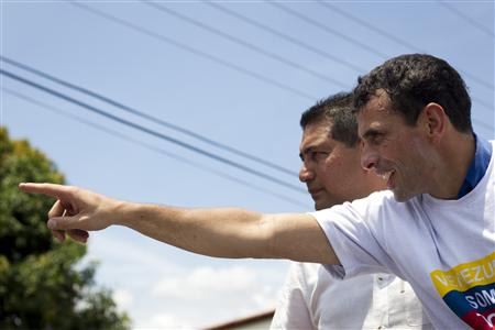 Venezuela's opposition leader and presidential candidate Capriles greets supporters during a rally in Ciudad Bolivar at the southern state of Bolivar