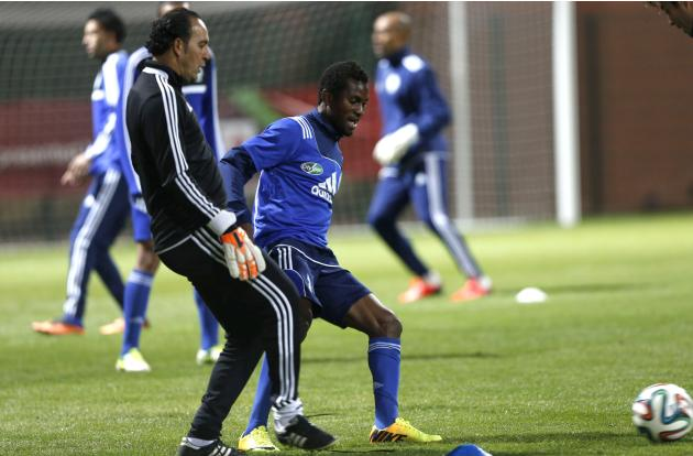 Kanda of Morocco's Raja Casablanca takes part in a training session with coach Chadili in Marrakech Stadium