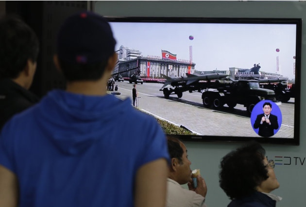 South Koreans watch TV news showing a footage of North Korean missiles on a military parade, at a Seoul Train Station in Seoul, South Korea, Saturday, May 18, 2013. North Korea fired three short-range