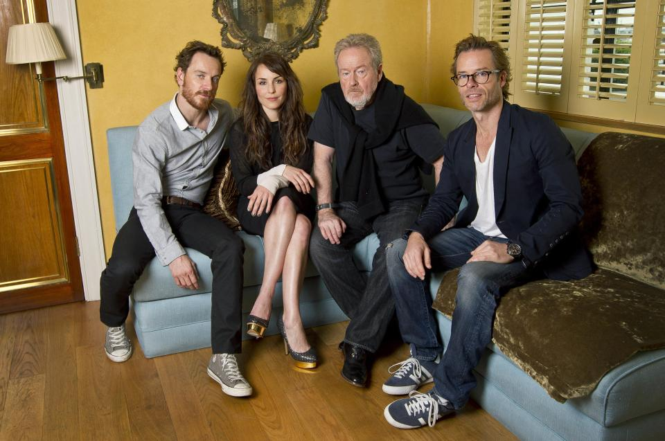 Actors Michael Fassbender, left, Noomi Rapace and Guy Pearce, right, pose for photographs with Director Sir Ridley Scott, at a central London hotel following an interview with the Associated Press for the World Premiere of Prometheus, Saturday, June 2, 2012. (AP Photo/Joel Ryan)
