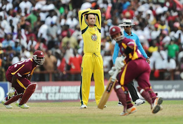 West Indies cricketers Carlton Baugh (R)