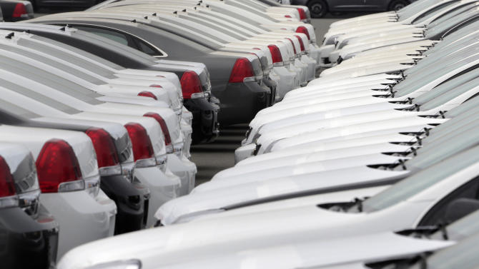 Automobiles for export and import park at a port in Kawasaki, south of Tokyo, Tuesday, April 30, 2013. Japan's manufacturing improved slightly in March, with factory output rising 0.2 percent, while the jobless rate also fell slightly. The Ministry of Economy, Trade and Industry said Tuesday that the figures, the fourth straight monthly increase, suggest the economy is poised for recovery. It cited strength in chemicals, electrical components, telecommunications equipment and steam turbines. (AP Photo/Itsuo Inouye)