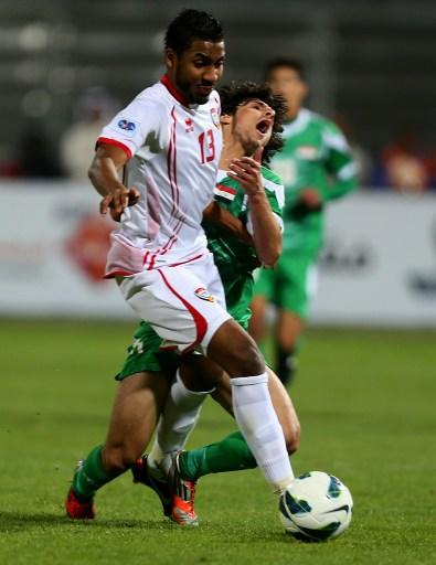 Humam Tariq Faraj (back) of Iraq vies with Khamis Ismail of UAE during the 21st Gulf Cup's final between United Arab Emirates (UAE) and Iraq on January 18, 2013 in Manama. United Arab Emirates won 2-1