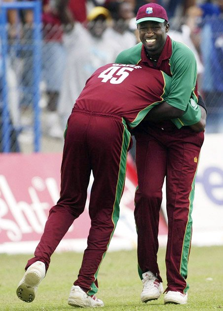 Wavell Hinds and Chris Gayle of the West Indies celebrate