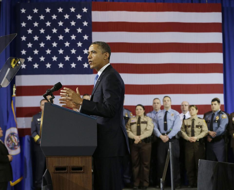 President Barack Obama gestures as he speaks about his gun violence proposals, Monday, Feb. 4, 2013, at the Minneapolis Police Department's Special Operations Center in Minneapolis, where he outlined his plan before law enforcement personnel.   (AP Photo/Pablo Martinez Monsivais)