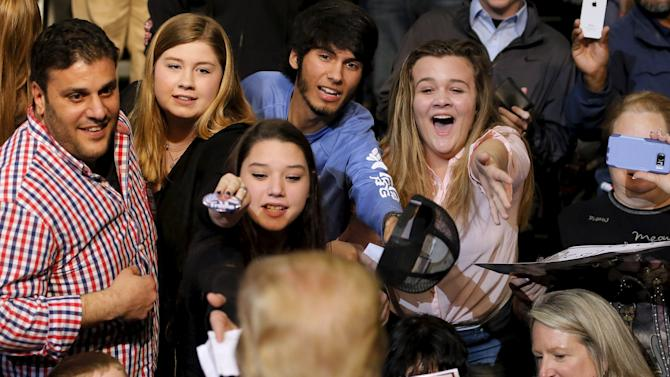 Republican U.S. presidential candidate Donald Trump greets young supporters after a rally in Baton Rouge, Louisiana