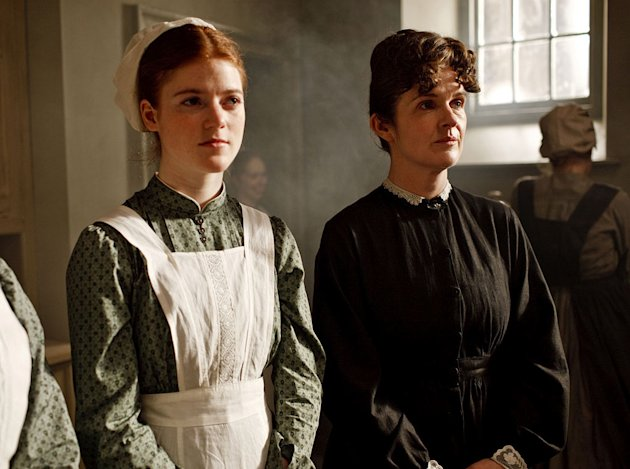 "Rose Leslie as Gwen and Siobhan Finneran as O'Brien in ""Downton Abbey."""