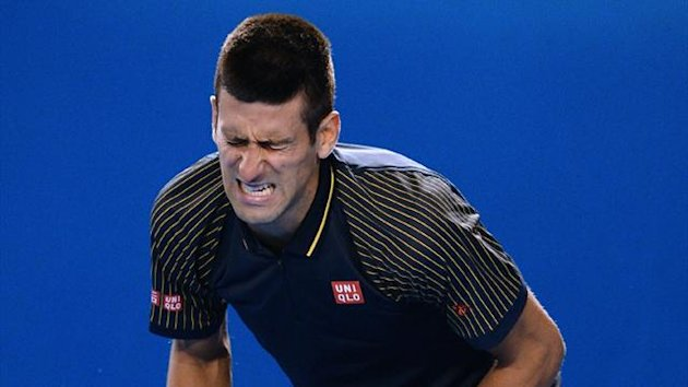 Novak Djokovic grimaces during his epic battle with Stan Wawrinka (AFP)
