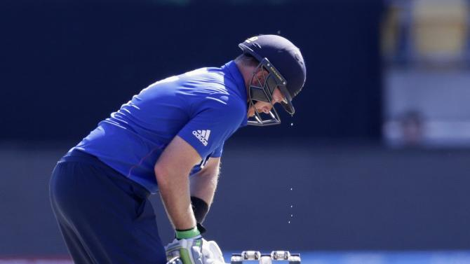 Sweat drips fropm the helmet of England's Bell as he bats against Sri Lanka during their Cricket World Cup match in Wellington