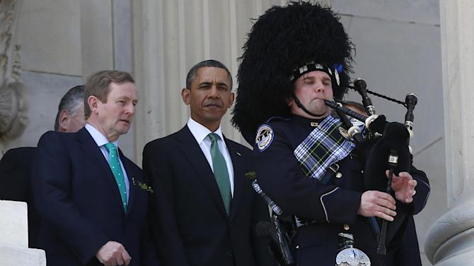 President Barack Obama and Irish Prime Minister Enda Kenny leave a St. Patrick's Day Luncheon on Capitol Hill in Washington, Tuesday, March 19, 2013. (AP Photo/Charles Dharapak)