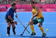 Jamie Dwyer (right) of Australia dribbles past Augustin Mazilli of Argentina during the men's field hockey preliminary round match at the Riverbank Arena in London. World champions Australia surrendered a two-goal lead as Argentina battled back for a 2-2 draw in men's Olympic hockey