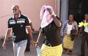 Somali pirates leave court in handcuffs after they were sentenced in the Kenyan coastal town of Mombasa