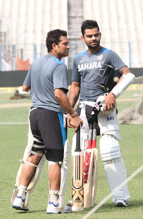 Indian Cricketers Sachin Tendulkar and Virat Kohli during a practice session ahead of test match between India and West Indies starting on Nov 6 at Eden Gardens in Kolkata on Nov.5, 2013. (Photo: IANS