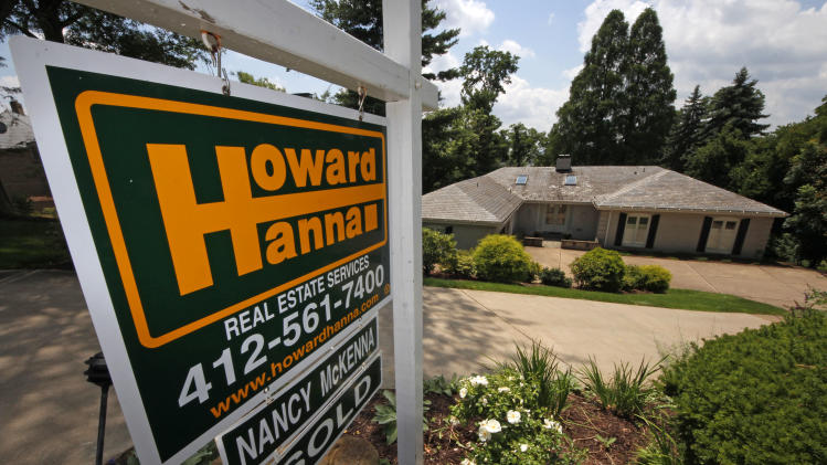 In this Tuesday, July 23, 2013, photo, a home is for sale in Mt. Lebanon, Pa. Freddie Mac reports on mortgage rates for this week on Thursday July 25, 2013. (AP Photo/Gene J. Puskar)
