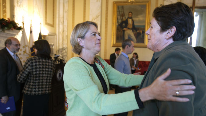 Rhode Island First Lady Stephanie Chafee, center, embraces Vice President of Patient Care Services of South County Hospital Barbara Seagrave following a news conference to discuss the state's efforts to encourage mothers to breastfeed infants, including eliminating the distribution of free infant formula to mothers when they are discharged from the hospital, at the State House in Providence, R.I., Monday, Nov. 28, 2011. (AP Photo/Michael Dwyer)