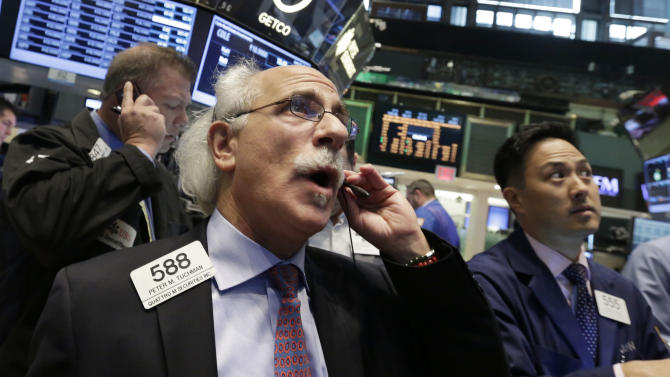 Trader Peter Tuchman, foreground left, works on the floor of the New York Stock Exchange, Friday, June 21, 2013. U.S. stocks rose in morning trading on Friday as traders regrouped following the biggest drop of the year. (AP Photo/Richard Drew)