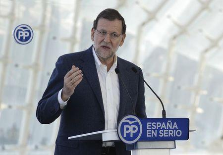 Spain's Rajoy vows to cut tax, create jobs if re-elected
