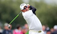 Prayad Marksaeng of Thailand watches his shot from the 4th tee during his second round on day two of the 2012 British Open Golf Championship at Royal Lytham and St Annes in England. Prayad's Open misery was extended for at least another year after missing his fifth cut