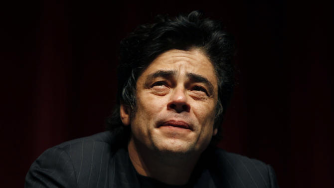 "Puerto Rican actor Benicio Del Toro pauses during a conference with Oliver Stone and students at the University of Puerto Rico in San Juan, Friday, Nov. 30, 2012. Del Toro didn't wait long to collect on a favor that Stone owed him for working extra hours on the set of his most recent movie, ""Savages"", released this year: a trip to his native Puerto Rico, which Stone hadn't visited since the early 1960s.  Both are in the U.S. Caribbean territory to raise money for the Art Museum of Puerto Rico, which is hosting its annual movie festival and will honor Stone's movies. (AP Photo/Ricardo Arduengo)"