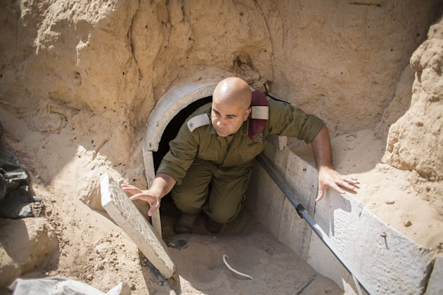 An Israeli soldier seen inside a tunnel built by Hamas militants leading from the Gaza Strip into Southern Israel, Aug. 4, 2014. (Ilia Yefimovich/Gett...