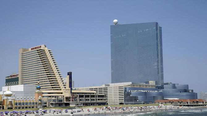 FILE - In this Wednesday, July 23, 2014 file photo, the Showboat Casino Hotel, left, and the Revel Casino Hotel, right, are seen along the Boardwalk in Atlantic City, N.J. Showboat is due to close on Sunday, Aug. 31, 2014 and Revel will close its hotel Monday and casino on Tuesday. Although, Caesars Entertainment spokesman Gary Thompson told The Associated Press that Caesars officials were showing the Showboat on Tuesday afternoon to a party that had expressed interest. (AP Photo/Mel Evans, file)