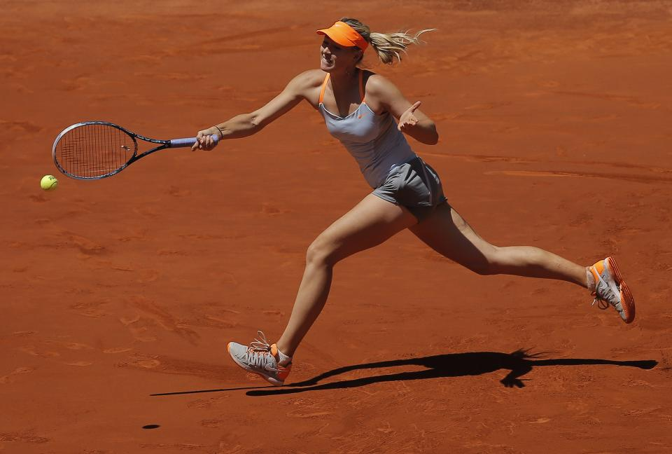 Maria Sharapova from Russia returns the ball during the women's final match against Serena Williams from the U.S. at the Madrid Open tennis tournament, in Madrid, Sunday, May 12, 2013. (AP Photo/Andres Kudacki)