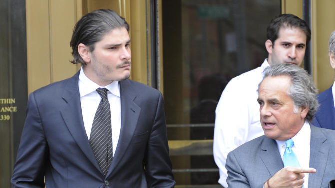Hillel Nahmad, left, exits Manhattan federal court with his attorney Benjamin Brafman, Friday, April 19, 2013, in New York. Nearly three dozen people were charged on Tuesday in what investigators said was a Russian organized crime operation that included illegal, high-stakes poker games for the rich and famous and threats of violence to make sure customers paid their debts. (AP Photo/ Louis Lanzano)