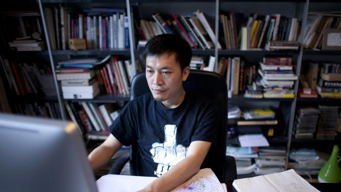 In this photo taken on July 31, 2012, Isaac Mao, a well-known Chinese blogger and the founder of Sharism Lab, a social media research group, works on a computer in Beijing. Mao had more than 30,000 users when his Weibo account was deleted in June after he made a series of questioning remarks about China's space program. (AP Photo/Alexander F. Yuan)