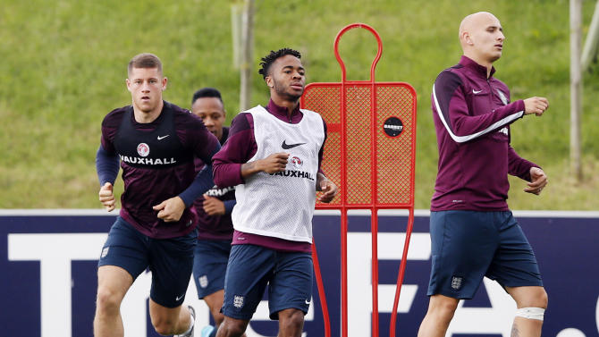 England's Ross Barkley, Raheem Sterling and Jonjo Shelvey during training