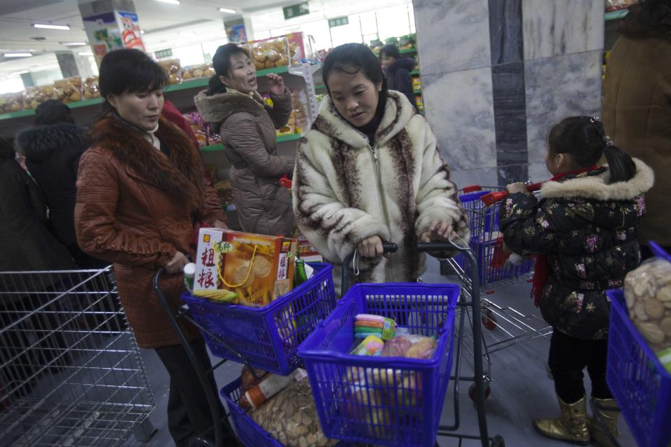 In this Thursday, Jan. 19, 2012 photo, people push their shopping carts at the Kwangbok Area shopping center to buy groceries in Pyongyang, North Korea. (AP Photo/David Guttenfelder)