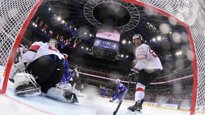 Switzerland's goaltender Genoni fails to save a goal from France's Raux during their Ice Hockey World Championship game at the O2 arena in Prague