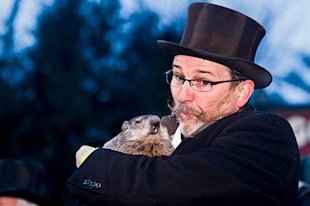 Groundhog handler Ben Hughes carries Phil at the 2010 Groundhog Day event in Punxsutawney, PA.