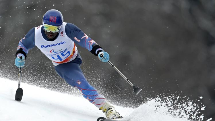 Green of the U.S. skis during the Men's Standing Skiing event of the Giant Slalom at the 2014 Sochi Paralympic Winter Games at the Rosa Khutor Alpine Center