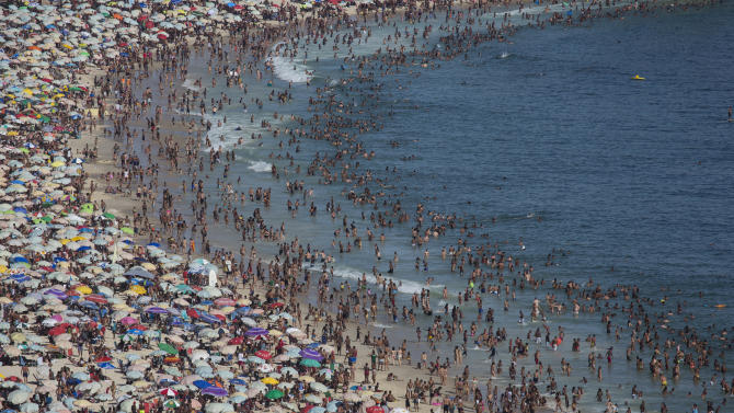 Thousands of beach goers pack Ipanema beach in Rio de Janeiro, Brazil, Sunday, Dec. 28, 2014. With temperatures reaching over 40 degrees celsius, (104 Fahrenheit), Rio beaches were packed on the last weekend of the year. (AP Photo/Felipe Dana)