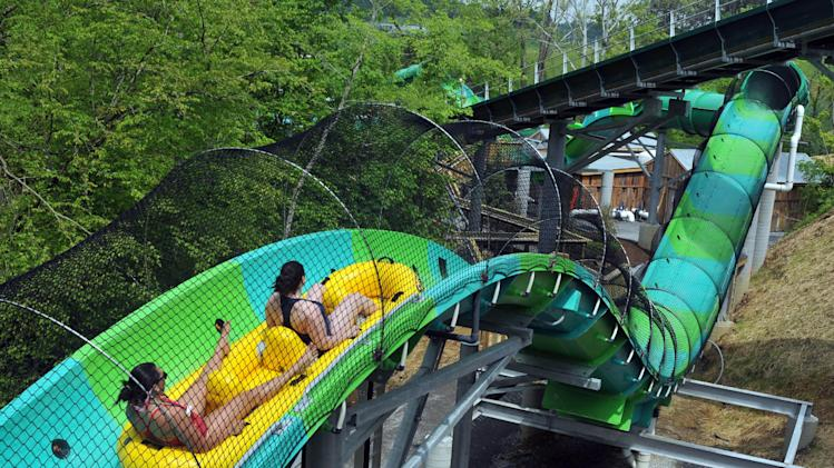 2013 file photo, visitors try out the new RiverRush ride at Dollywood