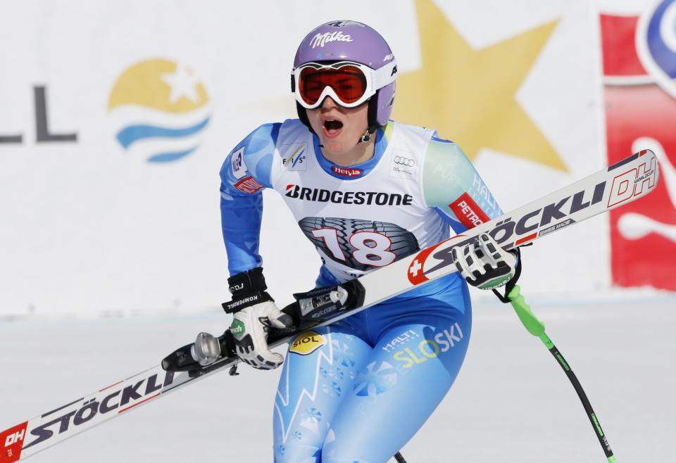 Slovenia's Tina Maze celebrates after winning an alpine ski, women's World Cup downhill, in Garmisch-Partenkirchen, Germany, Saturday, March 2, 2013. (AP Photo/Marco Trovati)