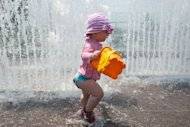 <p>A child cools off in a fountain in Washington, DC. A scorching heat wave searing the United States was expected to begin to ease slightly Sunday, but authorities warned that temperatures will still remain high and dangerous through most of the weekend.</p>