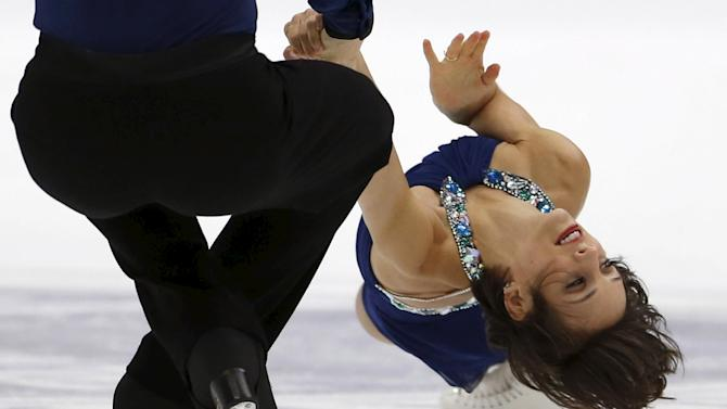 Meagan Duhamel and Eric Radford of Canada perform during the pairs free skating program at the ISU Grand Prix of Figure Skating in Nagano, Japan