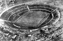 FILE - In this July 30, 1930 file photo, an aerial view of the Centenario stadium in Montevideo, Uruguay. Uruguay defeated Argentina 4-2 in the World Cup soccer final match. On this day: July 13, 1930 saw the first ever World Cup matches played. France defeated Mexico 4-1, while the US beat Belgium 3-0 at smaller stadiums, in Montevideo. (AP Photo/File)