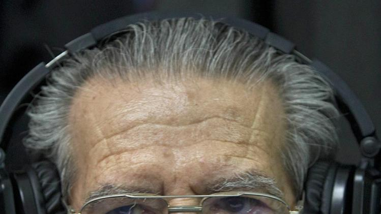 Guatemala's former dictator Jose Efrain Rios Montt wears headphones as he listens to the verdict in his genocide trial in Guatemala City, Friday, May 10, 2013. The Guatemalan court convicted Rios Montt on charges of genocide and crimes against humanity, sentencing him to 80 years in prison. The 86-year-old former general is the first former Latin American leader ever found guilty of such a charge. The war between the government and leftist rebels cost more than 200,000 lives and ended in peace accords in 1996. (AP Photo/Moises Castilo)