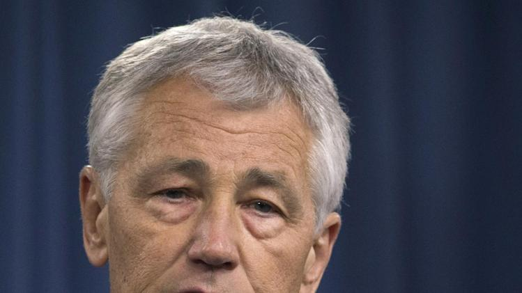 FILE - In this March 1, 2013 file photo, Defense Secretary Chuck Hagel speaks during a news conference at the Pentagon. Hagel plans to announce Friday that the Obama administration has decided to add 14 interceptors on the West Coast to the U.S.-based missile defense system. (AP Photo/Carolyn Kaster, File)