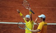 Chris Guccione (R) and Lleyton Hewitt of Australia celebrate after winning their Davis Cup World Group play-off doubles tennis match against the German team in Hamburg, northern Germany. They won 6-3, 6-2, 2-6, 7-6 (7/4 over German pair Benjamin Becker and Philipp Petzschner to give Australia a 2-1 lead over Germany