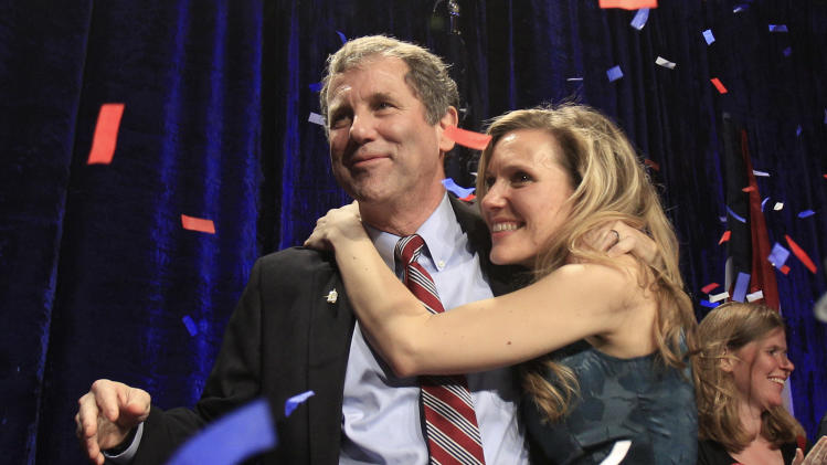 Democratic Sen. Sherrod Brown, left, is hugged by his daughter, Liz, as they celebrate at the Ohio Democratic party election night celebration  Tuesday, Nov. 6, 2012, in Columbus, Ohio. Brown defeated GOP challenger Josh Mandel, the state treasurer. (AP Photo/Tony Dejak)