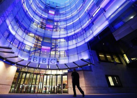 A man enters BBC New Broadcasting House in London
