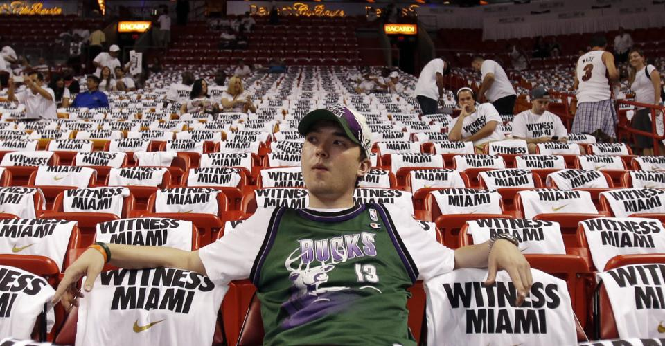 Milwaukee Bucks fan Jamie Gill, of Milwaukee, watches warmups before Game 1 of their first-round NBA basketball playoff series against the Miami Heat in Miami, Sunday, April 21, 2013. (AP Photo/Alan Diaz)