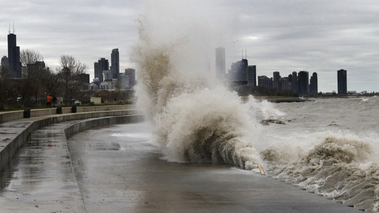 Strong waves crash against the Lake Michigan waterfront at the 31st Street Beach on the south side of Chicago on Tuesday, Oct. 30, 2012. Strong winds from the outer edge of superstorm Sandy are creating near-record high waves on Lake Michigan. (AP Photo/Charles Rex Arbogast)