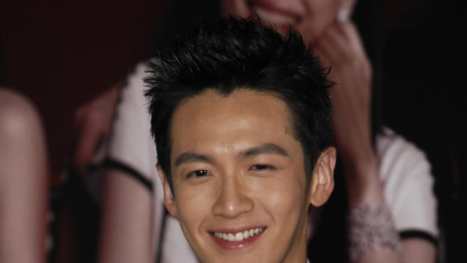 """FILE - In this April 15, 2012 file photo, Taiwanese actor Kai Ko poses on the red carpet of the 31st Hong Kong Film Awards in Hong Kong. Kai Ko plays """"Tung,"""" who goes to Nanyang Street to search for an ex-girlfriend who dumped him to go to cram school in director Hou Chi Jan's new film """"When a Wolf Falls in Love with a Sheep."""" (AP Photo/Kin Cheung, File)"""