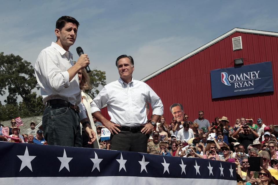 Republican presidential candidate, former Massachusetts Gov. Mitt Romney, right, listens and Republican vice presidential candidate, Rep. Paul Ryan, R-Wis., speaks during a campaign event at the Long Family Farm, Orchard & Cider Mill, Friday, Aug. 24, 2012 in Commerce, Mich.  (AP Photo/Mary Altaffer)